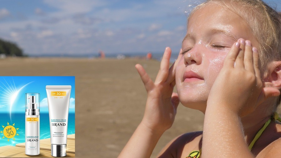 The girl apply sunscreen to face and body.