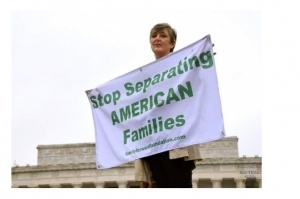 Connie-with-Separating-American-Families-sign-FB-300x199