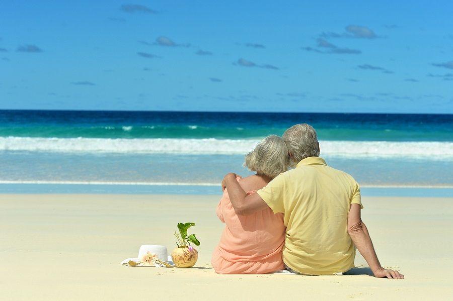 Elderly couple sitting on the shore