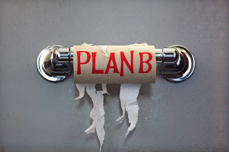 Empty roll of toilet paper with the phrase Plan B, concept for a