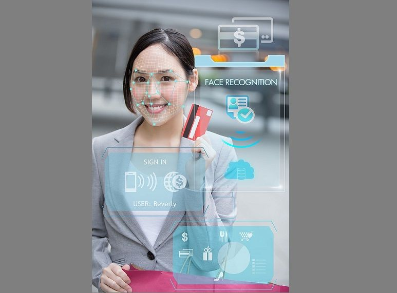 Asian businesswoman using credit card to payment with facial recognition