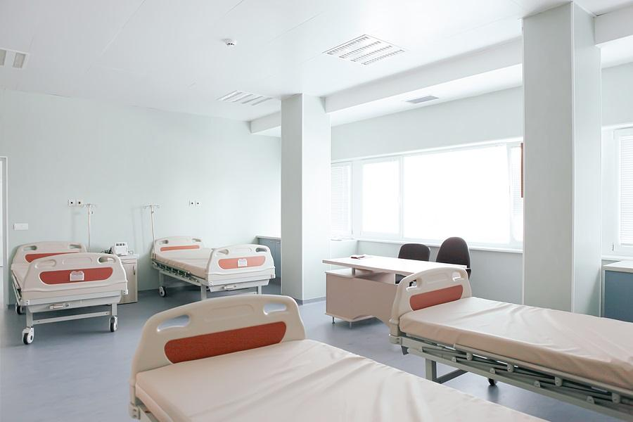 Modern Hospital Room. Hospital Bed In Clean And Modern Hospital.