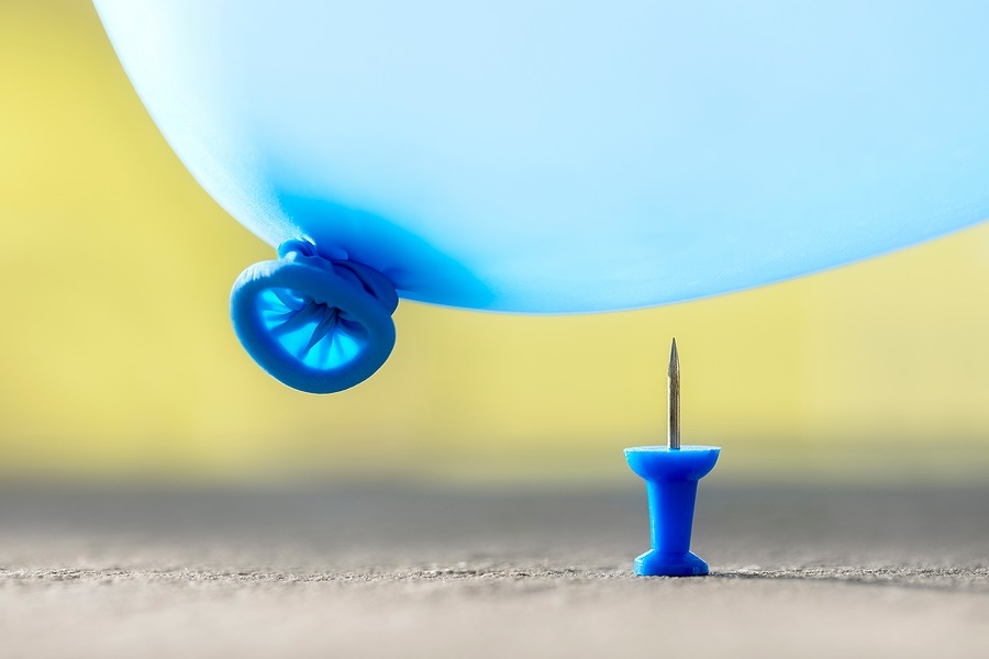 Burst your bubble thumb tack and balloon about to pop background